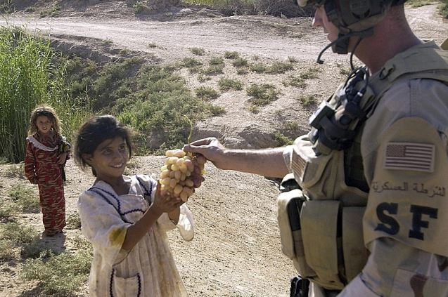 soldier giving food